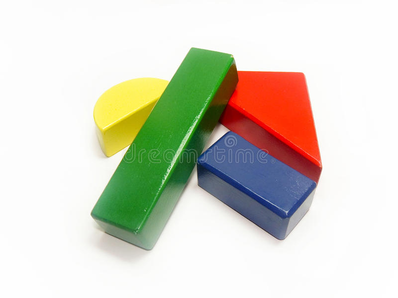Colorful wooden building block shapes. Randomly placed colorful wooden building block shapes in white background royalty free stock image