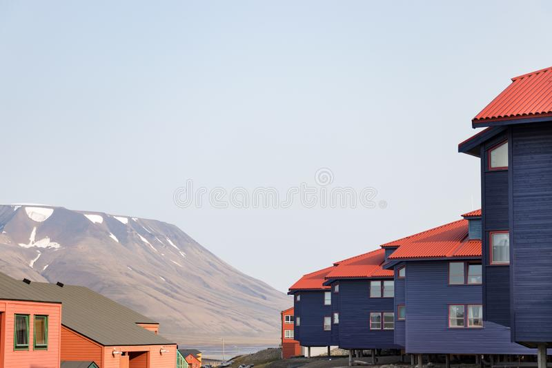 Colorful wooden buildings along the road in summer at Longyearbyen, Svalbard. Longyearbyen, Svalbard, Norway - August 13th, 2018: Colorful wooden buildings along royalty free stock photo