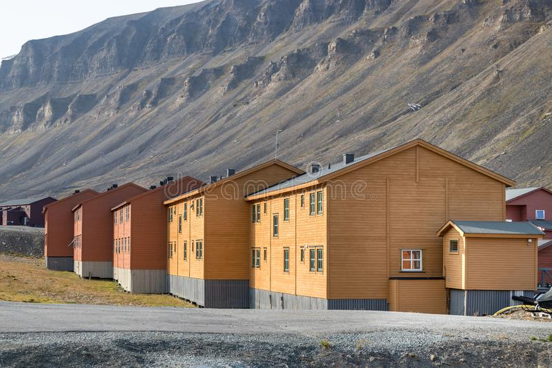 Colorful wooden buildings along the road in summer at Longyearbyen, Svalbard. Longyearbyen, Svalbard, Norway - August 13th, 2018: Colorful wooden buildings along royalty free stock images