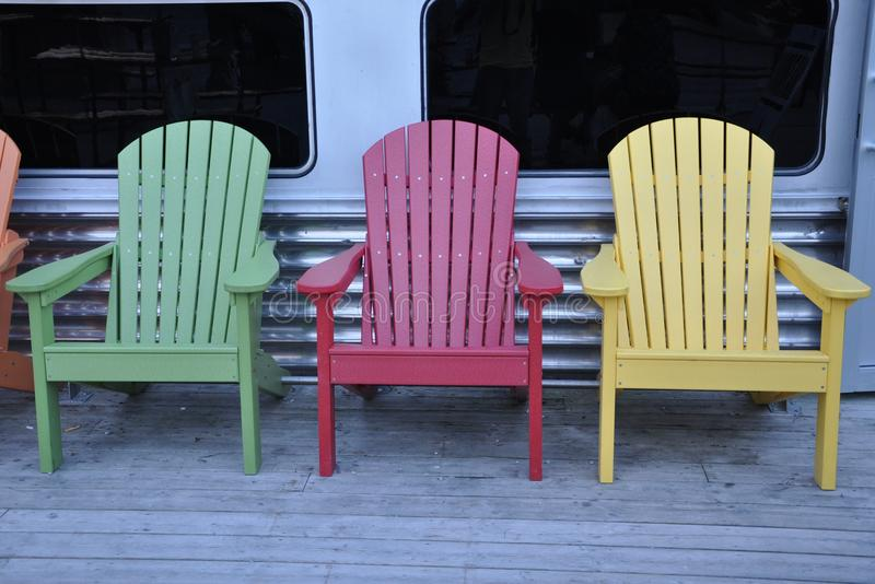 Colorful wooden chairs. Adorn the place stock photo