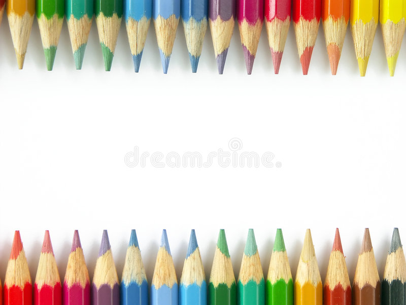 Colorful wooden crayons. Two rows of colorful wooden crayons royalty free stock photos