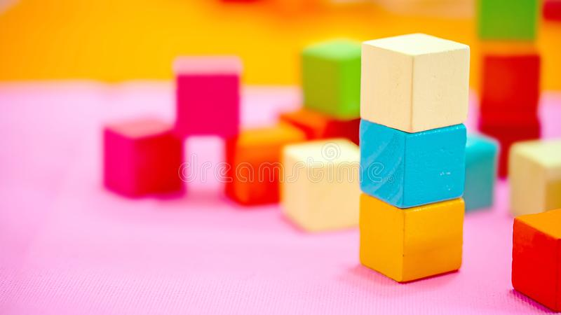 Colorful stack of wood cube building blocks. Colorful Wooden cube building blocks isolated on white background. Colorful stack of wood cube building blocks royalty free stock photos