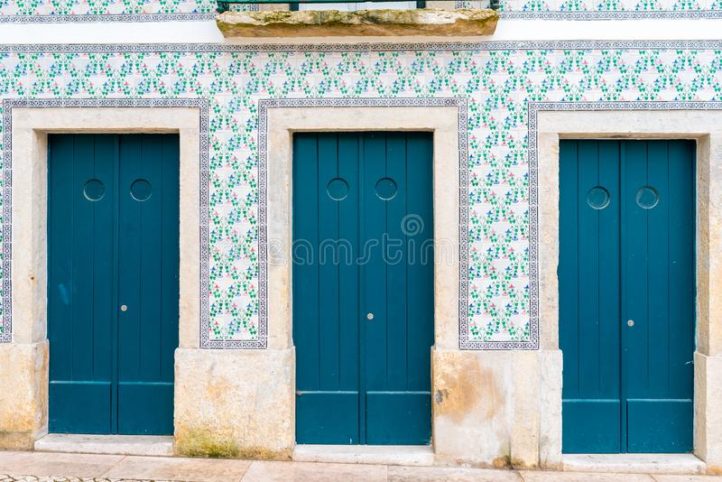 Colorful wooden doors in the facade of a typical Lisbon house, Portugal stock photos