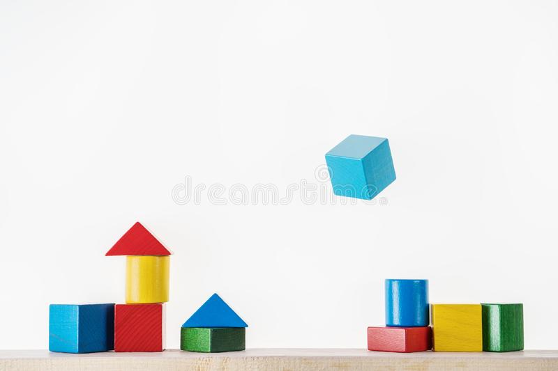 Colorful wooden geometric shapes are floating. Concept of creative, logical thinking. Abstract geometric real floating wooden blocks royalty free stock photo