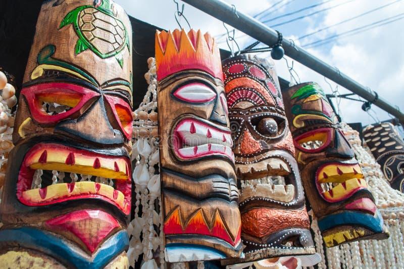 Hawaiian Tiki Masks sold at a local market in Hawaii. Colorful wooden Hawaiian Tiki Masks sold at a local market in Hawaii royalty free stock photos