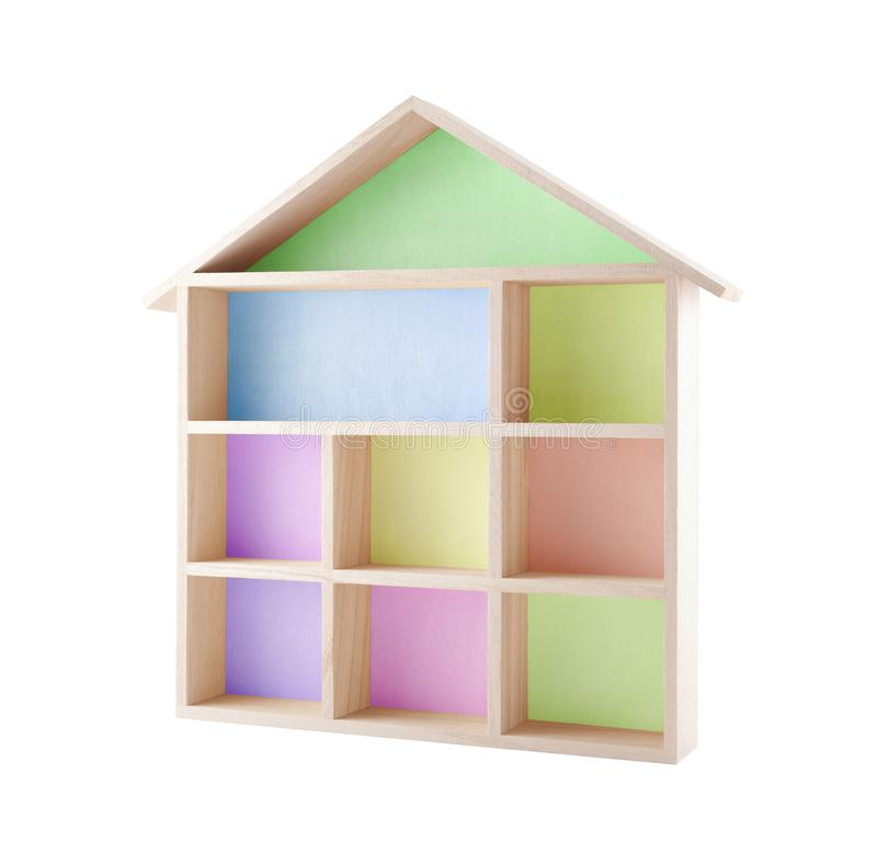 Colorful wooden house shaped shelf. Isolated on white royalty free stock photos