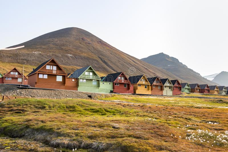 Colorful wooden houses along the road in summer at Longyearbyen, Svalbard. Colorful wooden houses along the road in summer, Longyearbyen, Svalbard, Norway royalty free stock images