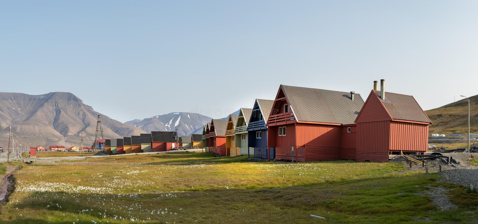 Colorful wooden houses along the road in summer at Longyearbyen, Svalbard. Longyearbyen, Svalbard, Norway - August 13th, 2018: Panorama of colorful wooden houses stock photo