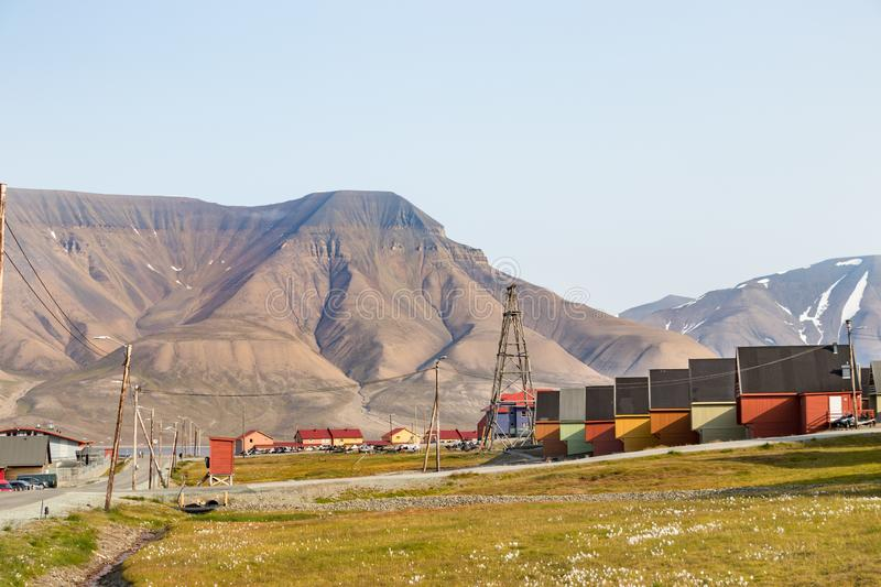 Colorful wooden houses along the road in summer at Longyearbyen, Svalbard. Longyearbyen, Svalbard, Norway - August 13th, 2018: Colorful wooden houses along the stock photos
