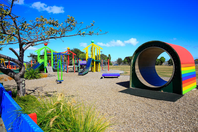 Colorful wooden Kids playground tunnel. Levin, New Zealand.  stock photo