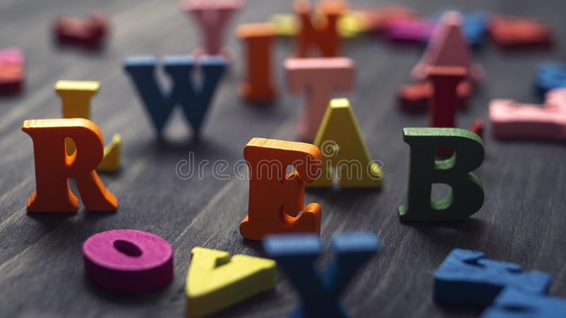 Colorful wooden letters on wooden background. Close up stock photos