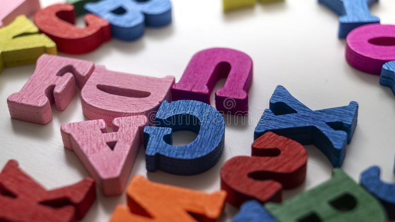 Colorful wooden letters on wooden background. Close up royalty free stock images