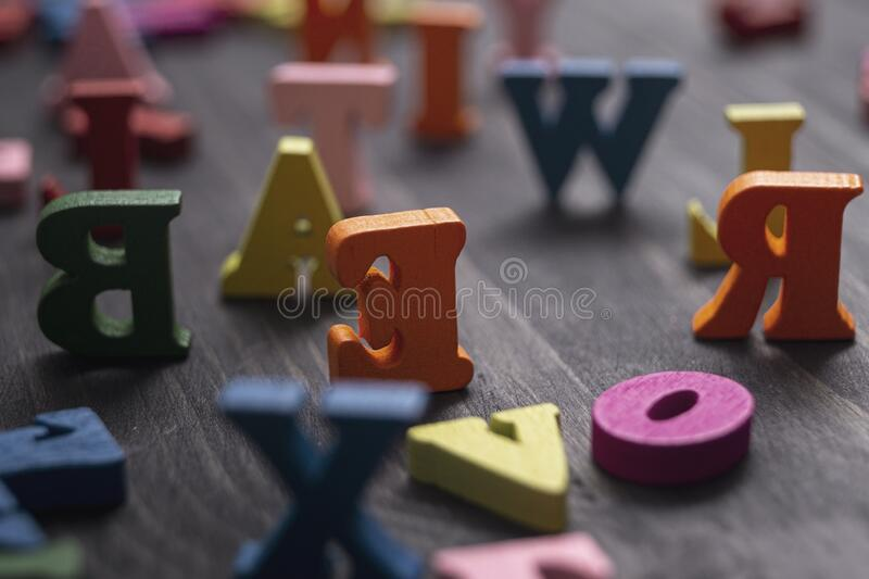 Colorful wooden letters on wooden background stock image
