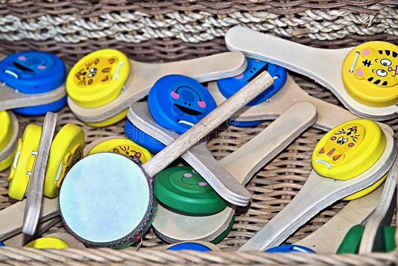 Colorful music instruments out of wood in Portugal. Colorful wooden music instruments for children at a market royalty free stock image