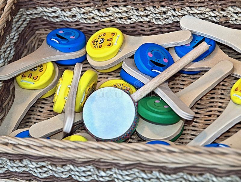 Colorful music instruments out of wood in Portugal. Colorful wooden music instruments for children at a market stock photo