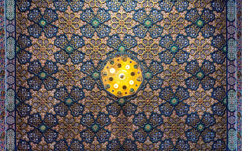 Colorful wooden ornate ceiling with floral and geometrical patterns at historic Manial Palace of Prince Mohammed Ali, Cairo, Egypt. Colorful wooden ornate stock photos