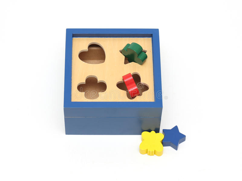 Colorful wooden puzzle game. Image of a colorful wooden puzzle game set for small children stock photo