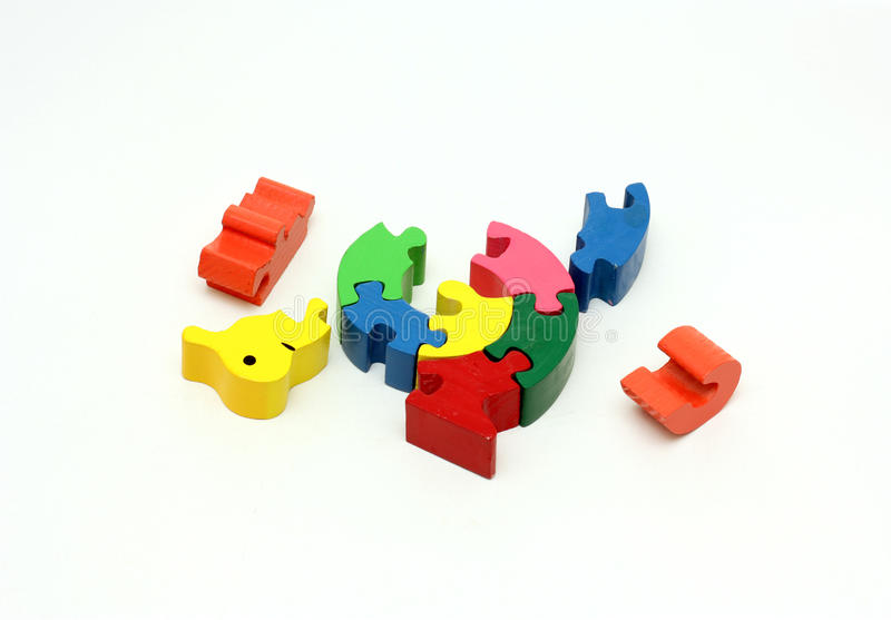 Colorful wooden puzzle game. Image of a colorful wooden puzzle game set for small children stock images