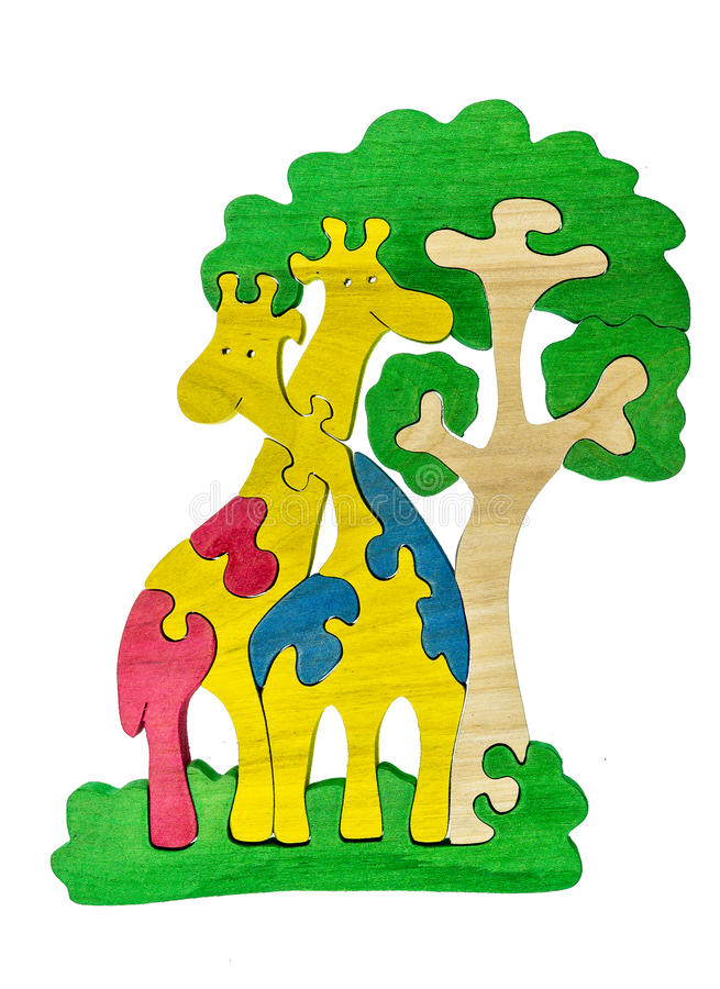 Colorful wooden puzzle pieces in giraffes and tree shape royalty free stock photo