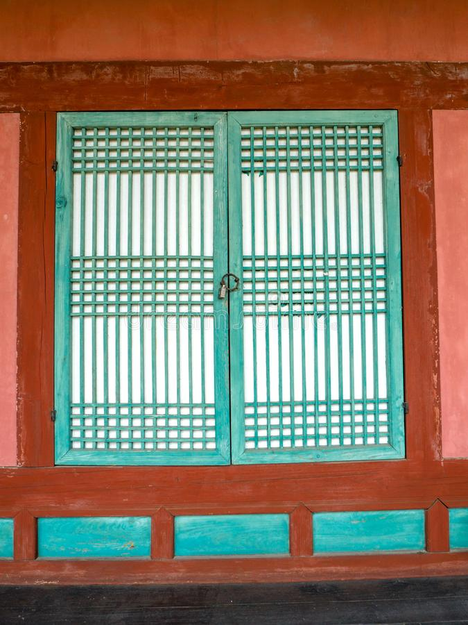 Colorful wooden red and teal window at a confucian temple in Korea royalty free stock images