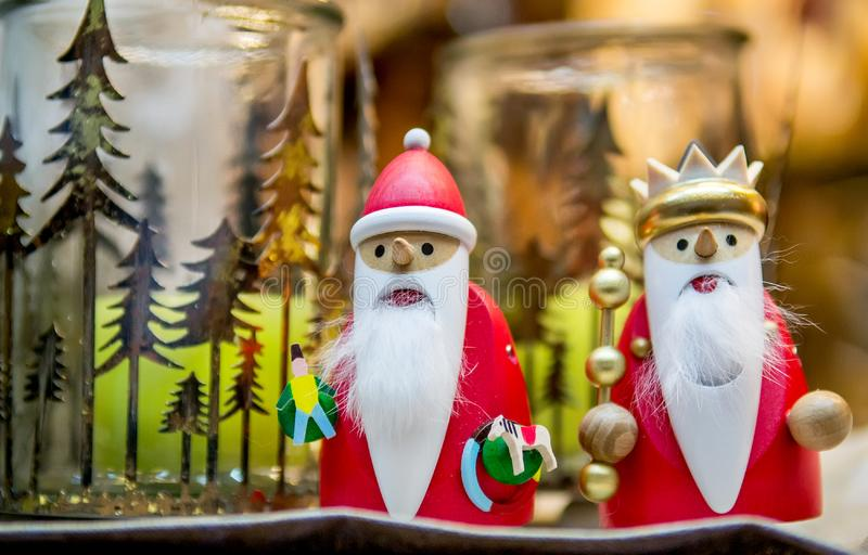 Wooden toy Santa Claus and king. Colorful wooden Santa Claus and king in a fair. Christmas background, the concept of new year holidays. Selective focus royalty free stock image