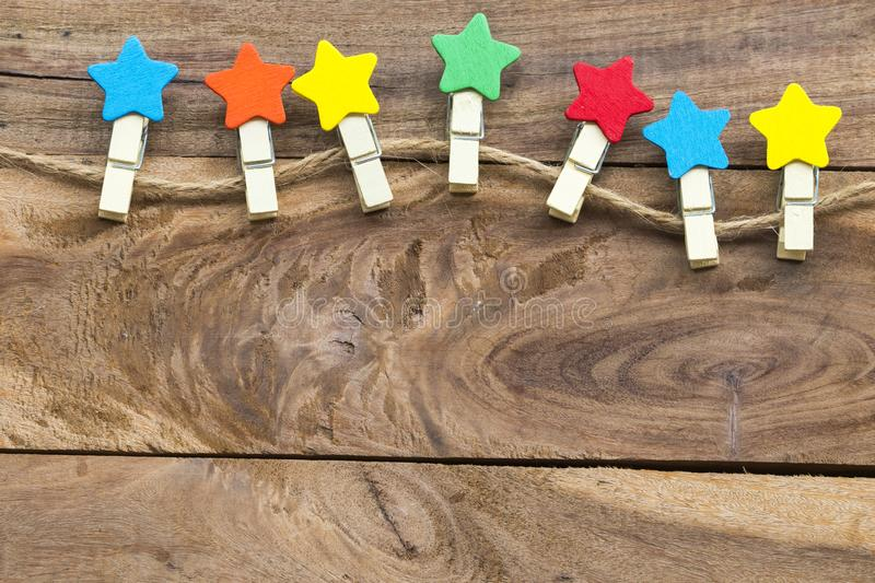 Colorful wooden star clips arrangement flat lay postcard style. On background wooden stock image