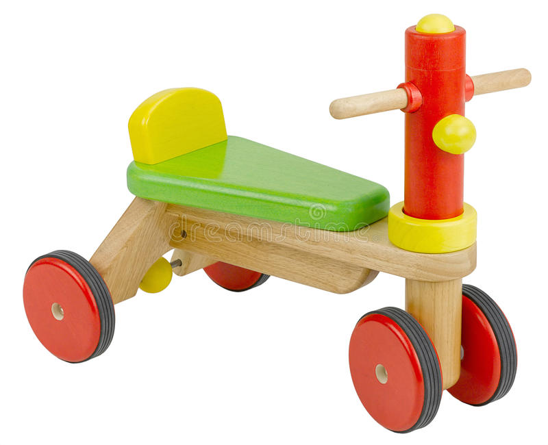Colorful wooden toy bicycle. Or motorcycle for children to play royalty free stock photo