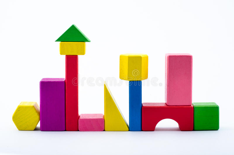 Colorful wooden toy block. Isolate from white background royalty free stock photo