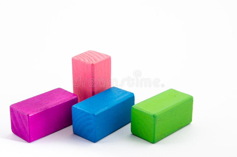 Colorful wooden toy block. Isolated from white background stock image