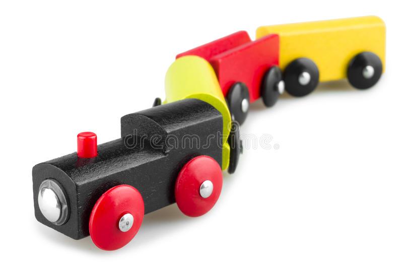 Colorful wooden toy train isolated over white background stock photography