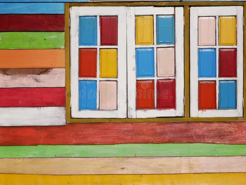 Colorful wooden wall and windows background stock photo