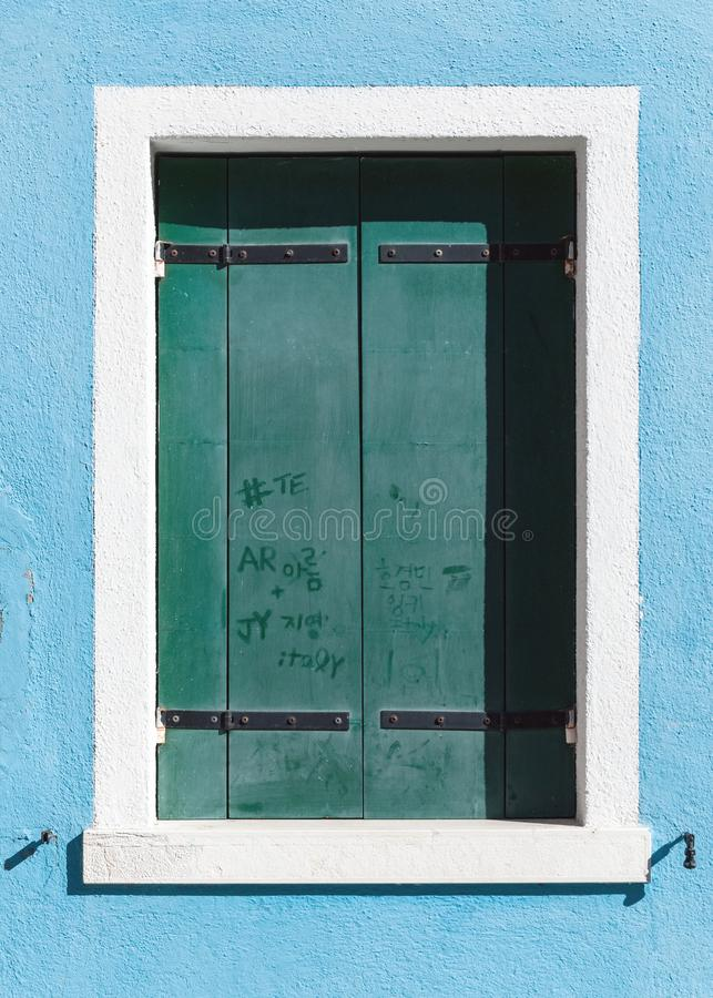 Colorful wooden window in Greece with secret love messages text blue, cyan, stock images