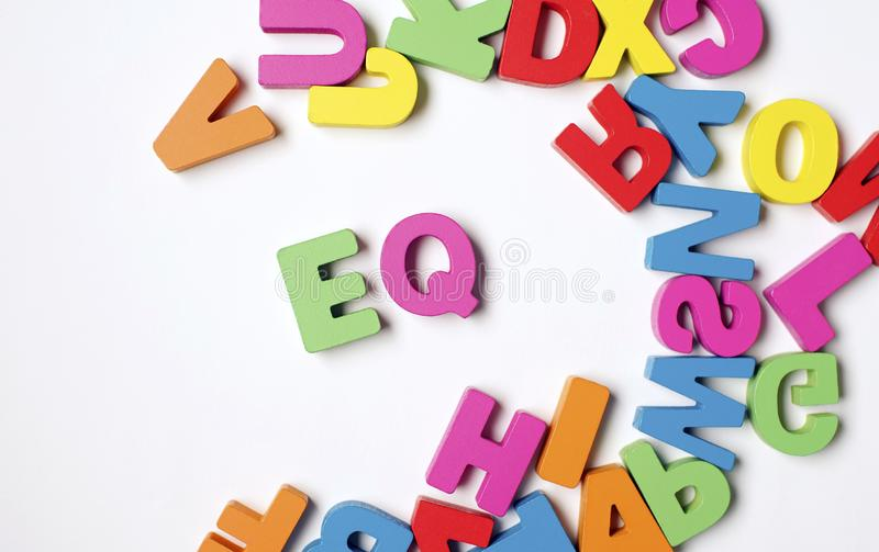Isolated Colorful Wooden Word ` EQ ` or Emotional Quotient royalty free stock photo