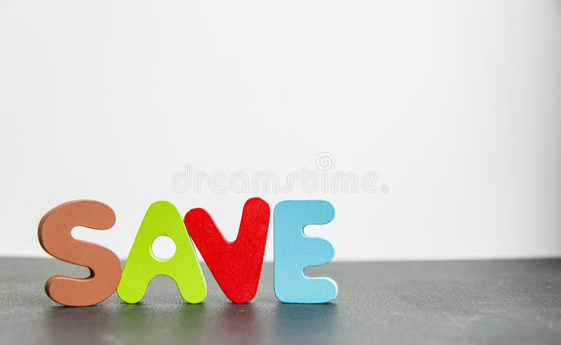 Colorful Wooden word save with white background1 stock photography
