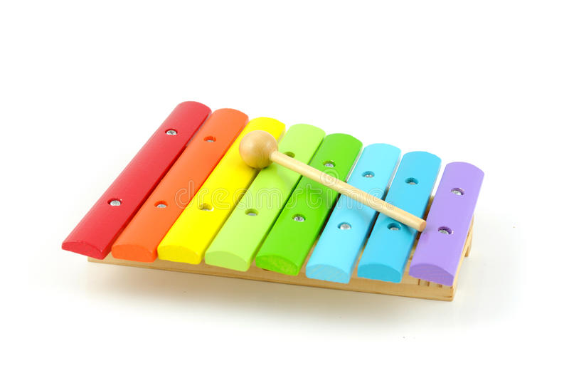 Colorful wooden xylophone with stick stock photography