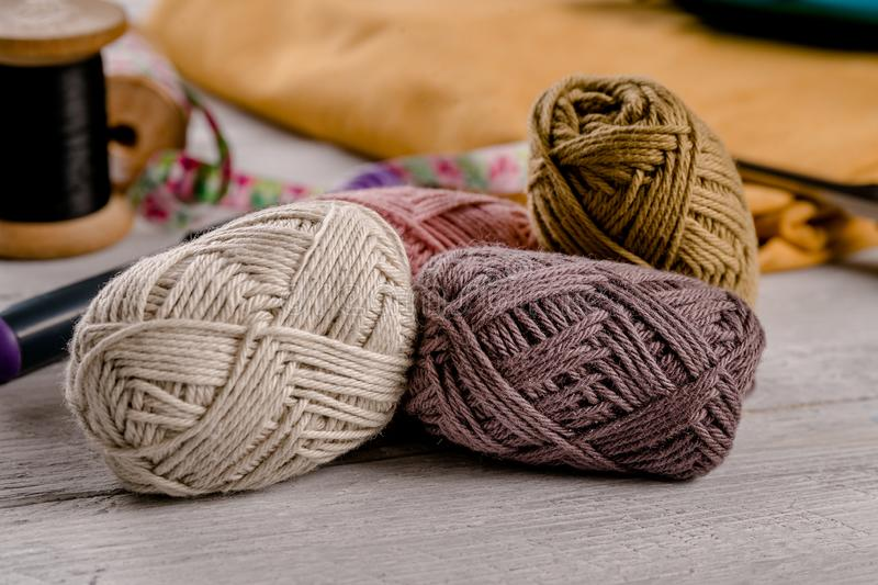 Colorful wool with colorful fabric in the background stock image