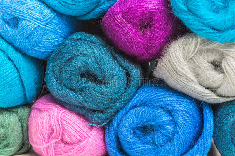 Colorful wool skeins of thread, industrial production. Close-up royalty free stock images
