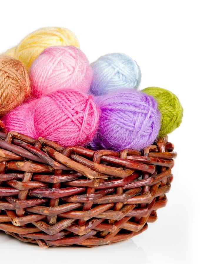 Colorful woolen yarn in a wicker basket stock photos