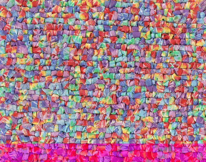 Colorful Woven Fabric. Full frame close-up of a mat woven with colorful fabric strips stock photos