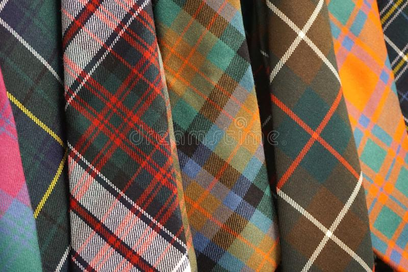 Colorful woven wool tartan plaid neckties stock photography