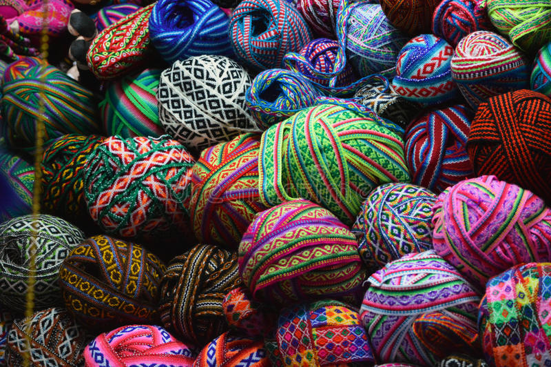 Colorful yarn balls on basket. At market stock image