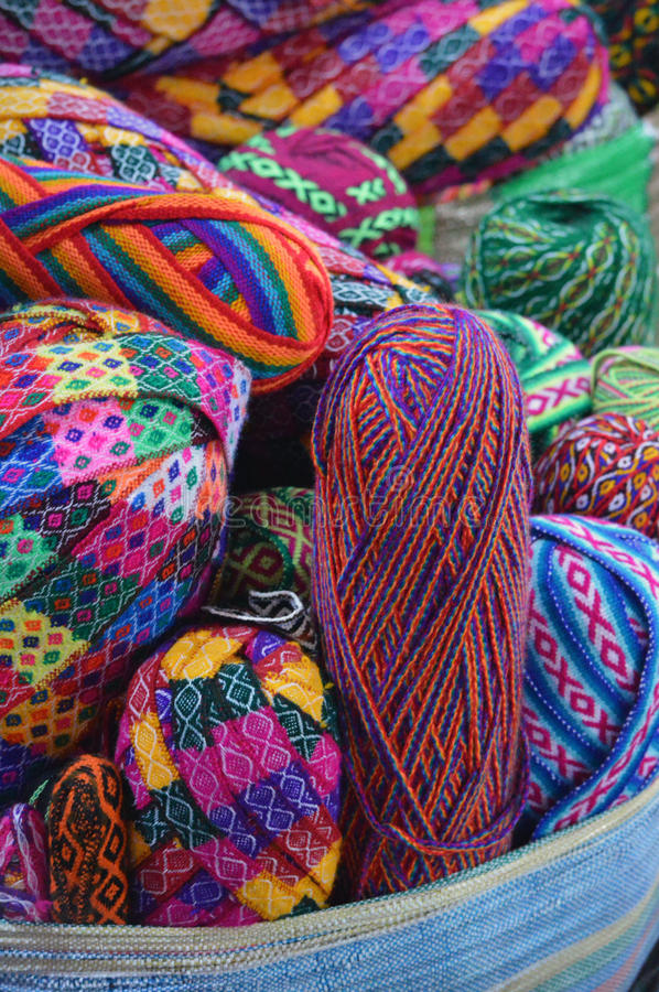 Colorful yarn balls on basket. At market stock photo