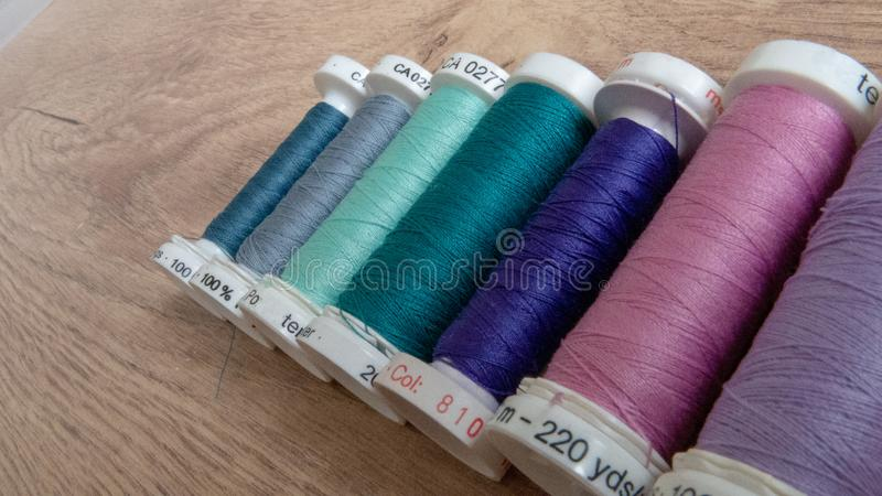 Colorful yarn on a wooden background. Colorful yarn for some handcrafts and sewing. leisure time royalty free stock photos