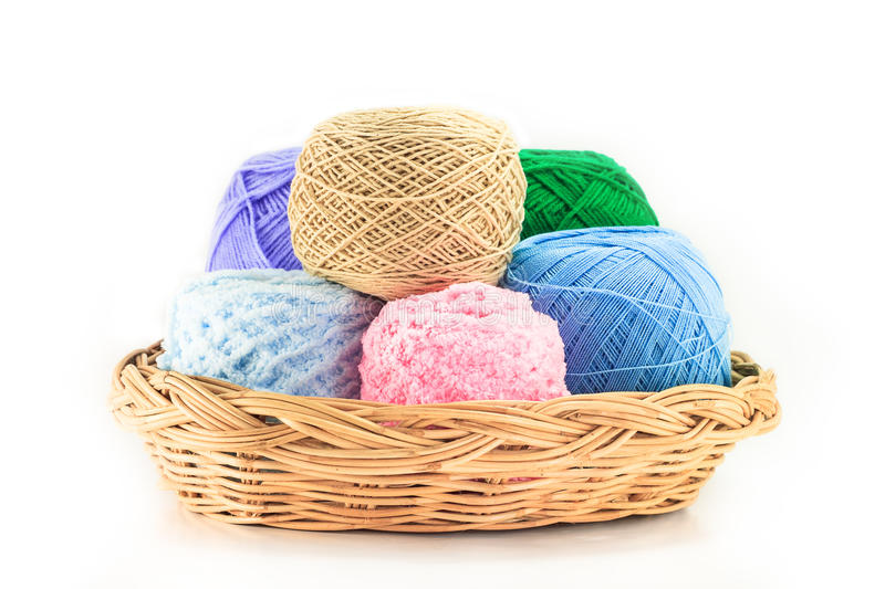 Colorful yarn in wicker basket. Isolated on white stock photos