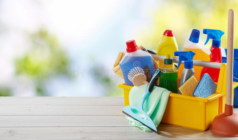 Colorful yellow box with cleaning supplies royalty free stock image