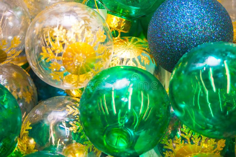 Colorful yellow, green and blue Christmas balls pattern background stock photography