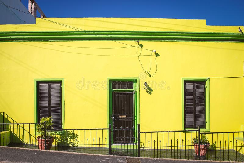 Colorful yellow and green facade of old house in Bo Kaap area. Cape Town stock photos