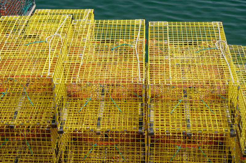 Colorful yellow stacked lobster traps make a unique abstract on stock photography