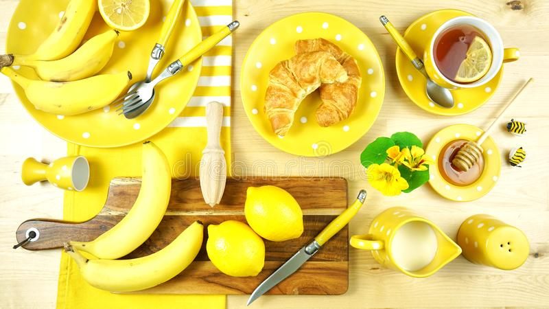 Colorful yellow theme breakfast brunch table setting flatlay. stock image