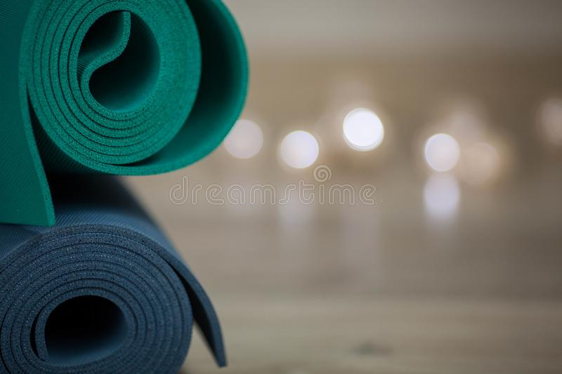 Colorful yoga mats are on the floor royalty free stock photography